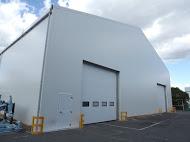 temporary building with a roller door entrance Industrial Buildings