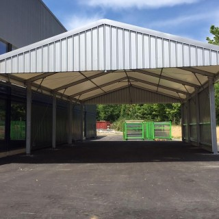a smaller canopy for extra warehouse space outdoors Temporary Building Types