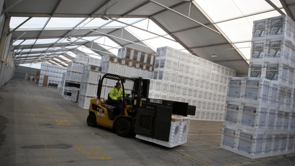 temporary warehouse where a forklift driver is moving white goods about Temporary Buildings Temporary Building Temporary