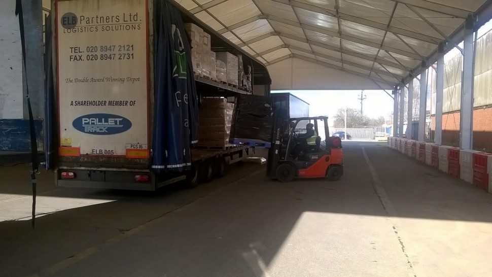Forklift driver working under one of Lauralu's temporary Industrial canopies Loading Bay Solutions